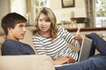 Mother And Teenage Son Arguing On Sofa At Home Royalty Free Stock Photo