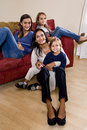 Mother and three children sitting at home together Royalty Free Stock Photos