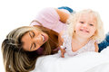 Mother tickling her daughter happy isolated over white background Stock Photo