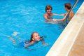 Mother train children to swim in the pool teaches summer outdoor Stock Images