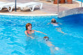 Mother train children to swim in the pool teaches summer outdoor Royalty Free Stock Photos