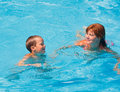 Mother train her son to swim in the pool summer outdoor Royalty Free Stock Image