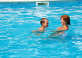 Mother train her son to swim in the pool summer outdoor Stock Image