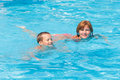 Mother train her son to swim in the pool summer outdoor Stock Images