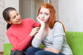 Mother tries reconcile with teen daughter her in home focus on girl Royalty Free Stock Photo