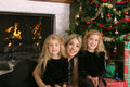 Mother with twin daughters at christmas Royalty Free Stock Images