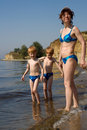 Mother and twins on beach Royalty Free Stock Photography