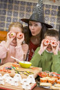 Mother and two children at Halloween playing Stock Photography