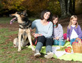 Mother with two dughters and a dog Royalty Free Stock Photography