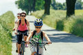 Mother with two sons on bicycle trip riding focus to son Stock Photo