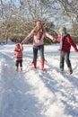 Mother Walking With Children Through Snowy Landsca Stock Photos