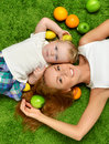 Mother woman and daughter child baby kid girl lying down Royalty Free Stock Photo