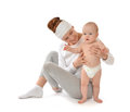 Mother woman holding and hugging in her arms infant child baby k Royalty Free Stock Photo