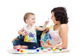 Mother wtih kid boy drawing painting together Royalty Free Stock Photography