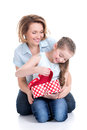 Mother and young daughter looking into the box with gift portrait of happy white isolated Royalty Free Stock Image
