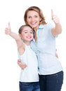 Mother and young daughter with thumbs up portrait of happy white isolated happy family people concept Stock Images