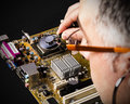 Motherboard diagnostic by person with stethoscope Royalty Free Stock Photography