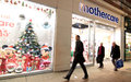 Mothercare people passing by shop in london Stock Photography