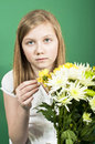 Mothering sunday a pretty girl holding a bunch of flowers for mothers day Royalty Free Stock Image