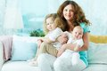 Motherly love lovely women expressing her by hugging her babies Stock Photography
