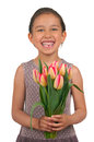 Mothers day beautiful little girl giving flowers for or birthday Royalty Free Stock Photo