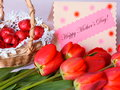 Mothers day card stock photos with happy mother s text red tulips and chocolates Royalty Free Stock Photo