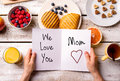 Mothers day composition. Greeting card and breakfast meal. Royalty Free Stock Photo