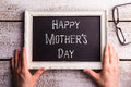 Mothers day composition. Hands of mom holding picture frame Royalty Free Stock Photo
