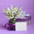 Mothers day easter flower card spring stock photos or white lily of the valley in the vase on purple background Royalty Free Stock Images