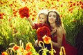 Mothers day, girl and little boy in field of poppy Royalty Free Stock Photo