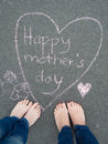 Mothers day - heart shape chalk drawing and the feet of a child Royalty Free Stock Photo