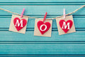 Mothers day message on felt hearts over blue wooden board Stock Photo