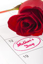 Mothers day red rose bud on calendar showing Royalty Free Stock Photo