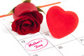 Mothers day red rose bud and red heart on calendar showing Royalty Free Stock Images