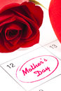 Mothers day red rose bud and red heart on calendar showing Stock Image