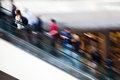 Motion blur people on an escalator traveling in of airport Stock Photography