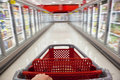 Motion Blur Shopping Trolley in Supermarket Stock Photo