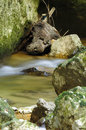 Motion blur water through rocks mountain flowing Stock Photos