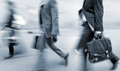 Motion blurred business people walking on the street at rush hour in in style of blur and blue tonality Royalty Free Stock Photos