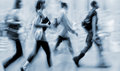 Motion blurred business people walking on the street Royalty Free Stock Photo