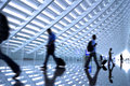Motion blurred commuters At the airport Royalty Free Stock Photo
