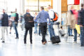 Motion blurred commuters people in interior Stock Images