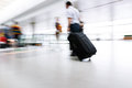 Motion blurred commuters at the subway station Royalty Free Stock Photo