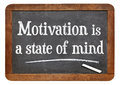 Motivation is a state of mind motivational phrase on vintage slate blackboard Stock Images