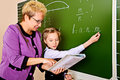 Motivation a teacher and her student during class at school education Royalty Free Stock Image