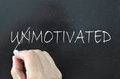 Motivation the word unmotivated crossed out to reveal motivated Royalty Free Stock Photo