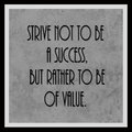 Motivational poster strive not to be a success but rather to be of value on a black and white grunge effect background Stock Images