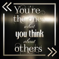 Motivational typographic quote in frame on blurred background