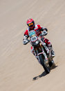Moto biker races a Rally Stock Image