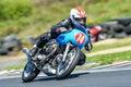 Moto guzzi on a race track blue motorcycle at hampton downs new zealand Stock Image